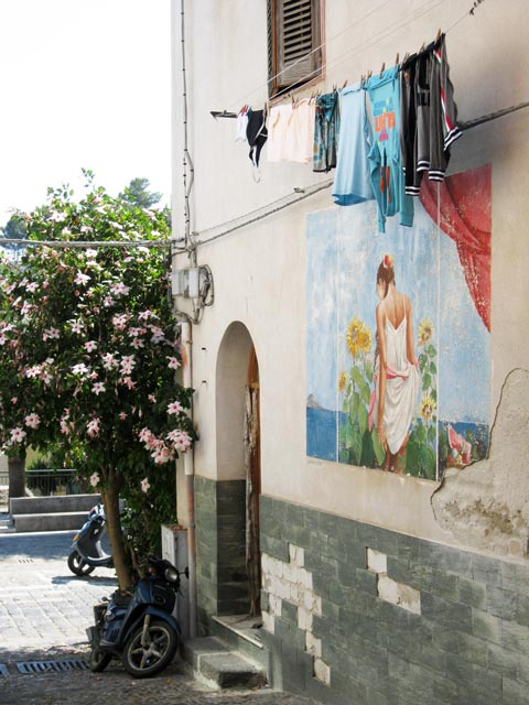 ustica-where-the-colors-of-a-hanging-wash-blend-with-a-mural