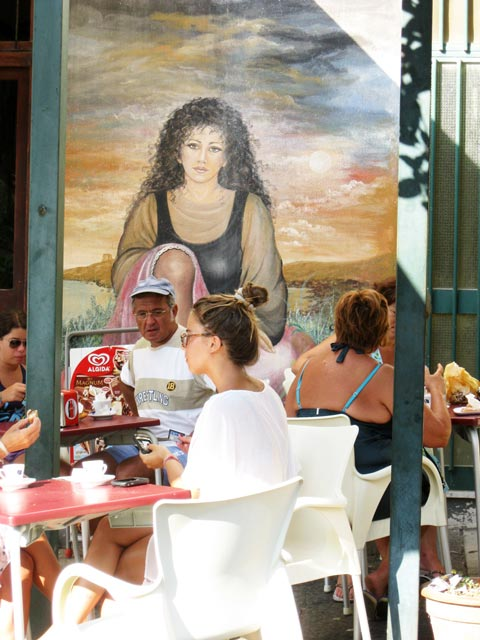 ustica-woman-on-painted-wall-mural-seems-to-gaze-dreamily-on-cafe-clients