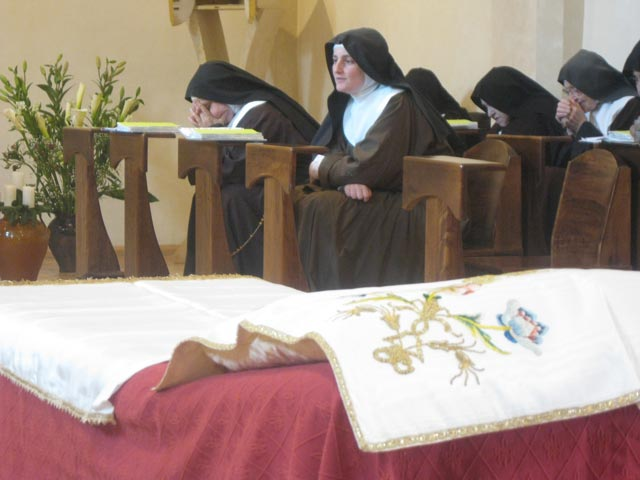 Contemplative-Poor-Clares-await-the-Cristo-Morto-near-the-bier-prepared-for-Him