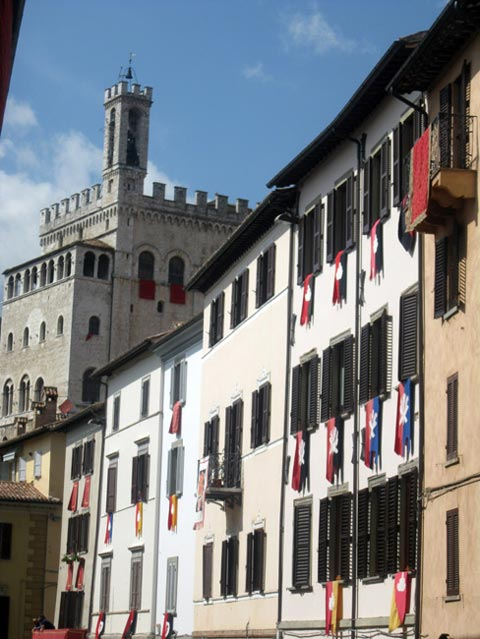 Banner-draped-homes-of-Gubbio-backed-by-the-Palazzo-dei-Consoli