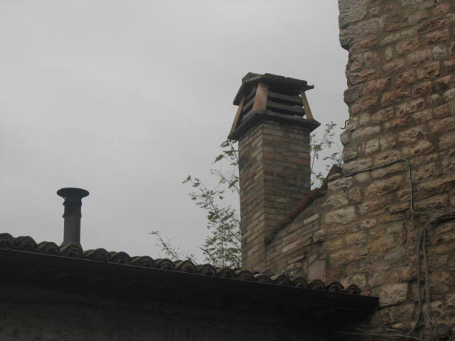Woodstove-pipes-and-chimneys-are-often-in-pairs-on-Assisi-rooftops