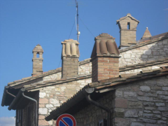 Assisi-chimney-clusters-form-a-sculpture-piece