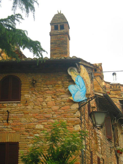 Assisi-chimney-towers-over-Christmas-decorations