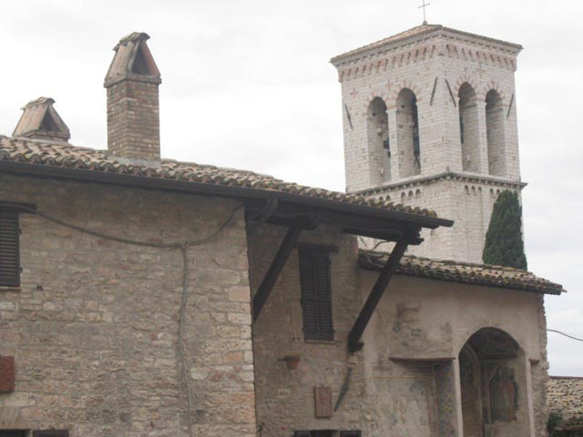 Medieval-belltower-flanks-Assisi-chimneys