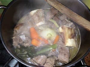 First step - simmer the beef in whie wine with beef bones