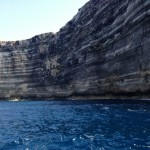 Lampedusa rock stratifications viewed from the sea
