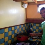 Pietro about to cook lunch in the boat galley