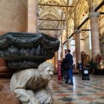 Curious_hunchback_holy_water_font_in_a_Gothic_Verona_church