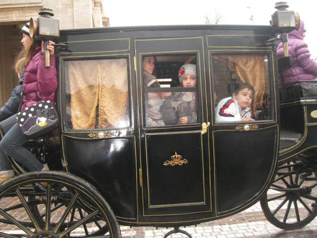 Children-ride-a-stagecoach-in-the-procession