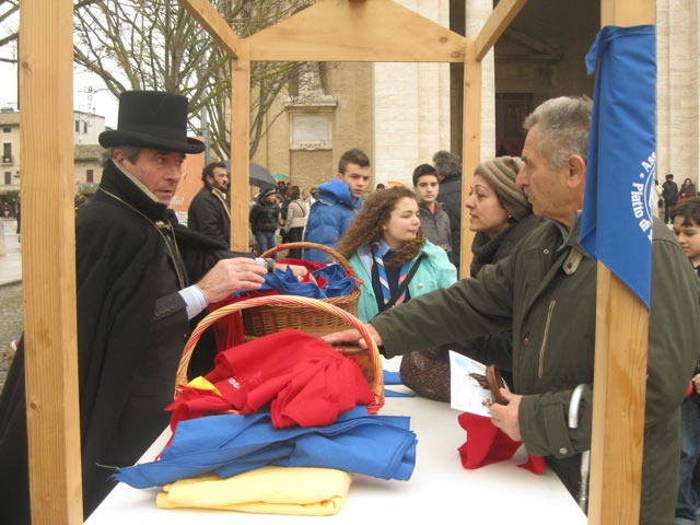 Priore-Servente-distributes-kerchiefs-for-animal-blessings