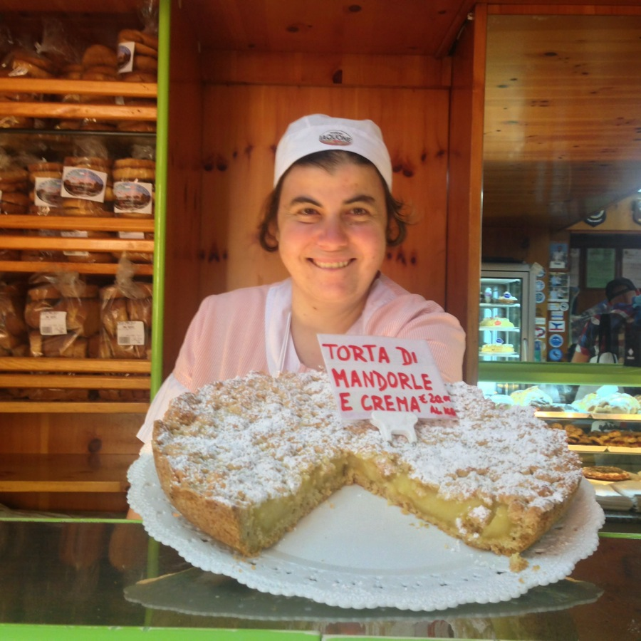 Francesca Aiello holds up one of the Forno favorites, an almond cake