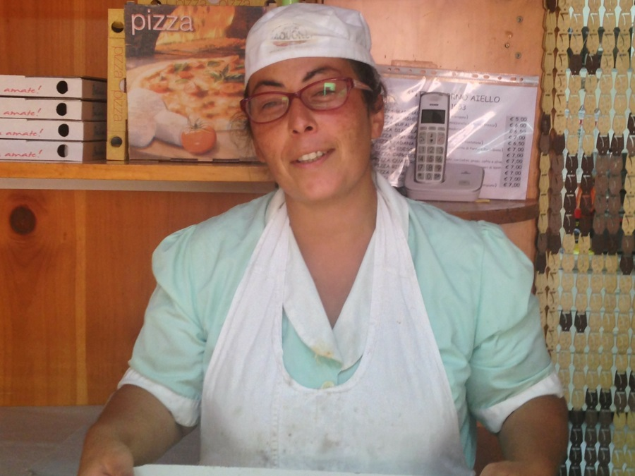 Teresa Aiello works with sister Francesca behind the counter