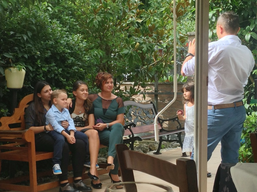 Sharing family photos in the garden of the restaurant