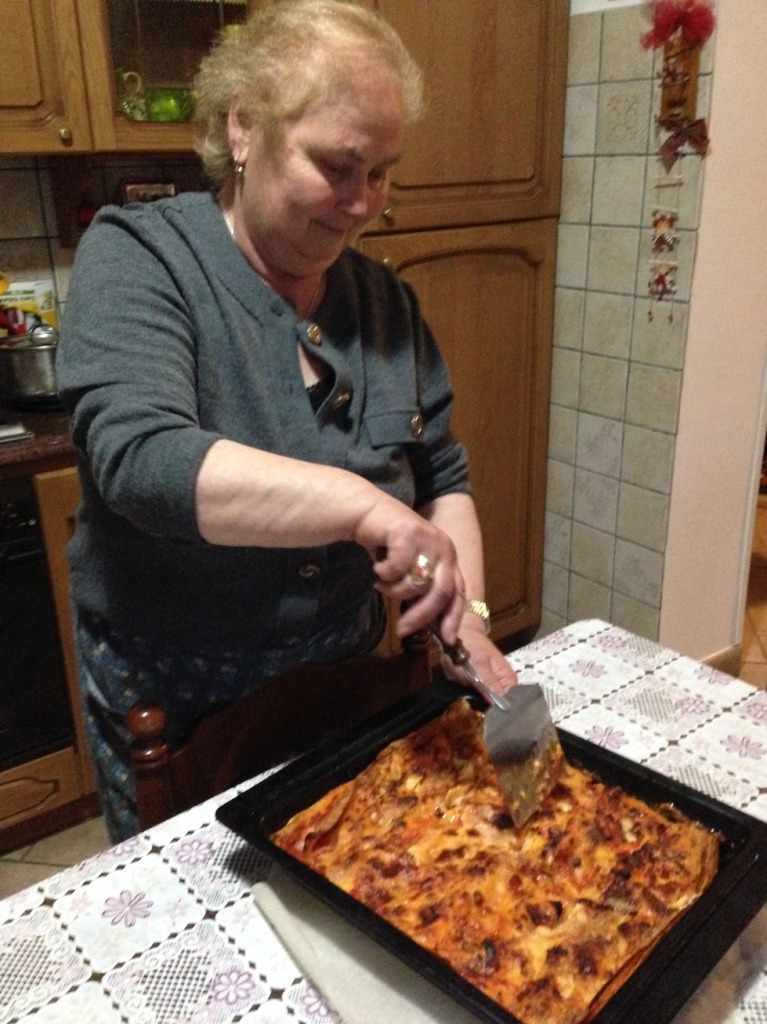 Chiarina serves up her lasagne, baked in the wood oven