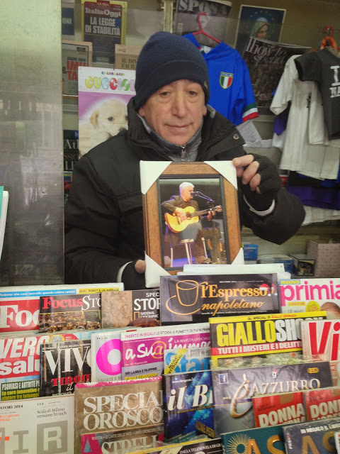 Francesco sells Pino photos along with newspapers