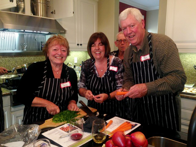 Barbara, John, Jan and Ron team in the kitchen