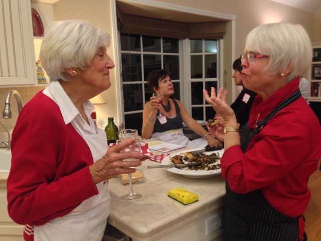 Blanche and host, Alicia, connect in the kitchen