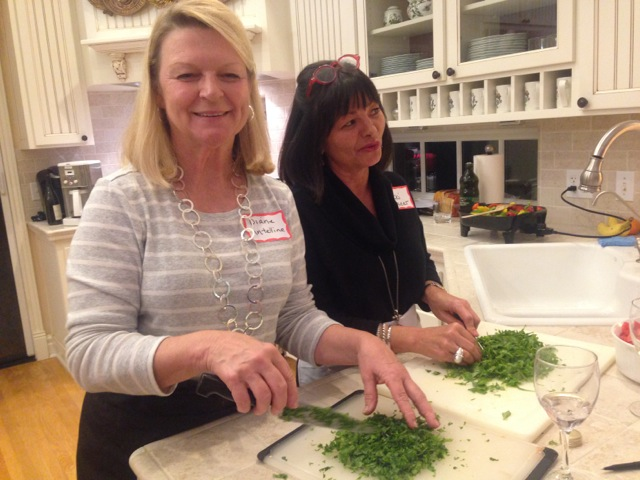 Diane and Andrea team up on the arugula prep