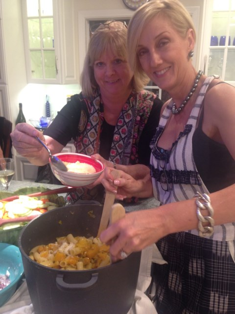 Host Deirdre adds Parmesan to our pasta, highlighted with Anne's butternut squash
