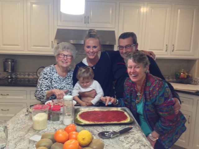 Three generations on pizza in Vivian's kitchen - before our cooking class!