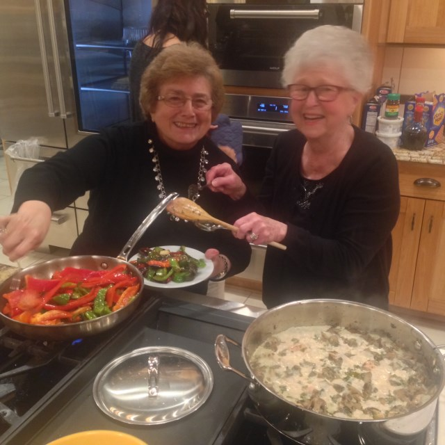 Angela and Vivian - born in Bari - team on cooking at our dinner