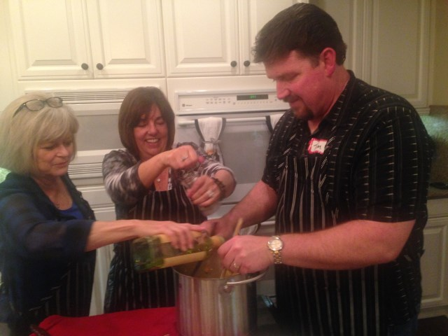 Jan adds ground black pepper to the pasta