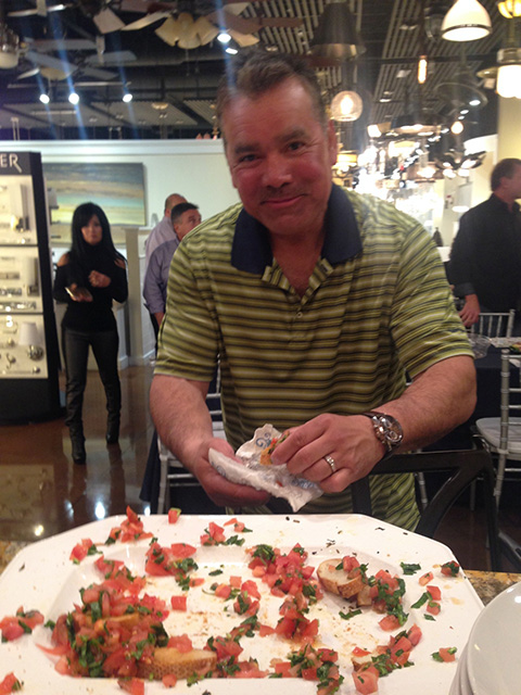 Jeff digs into the bruschettta