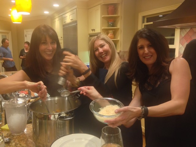 Julie, Cheryl and Laura team on the pasta-serving