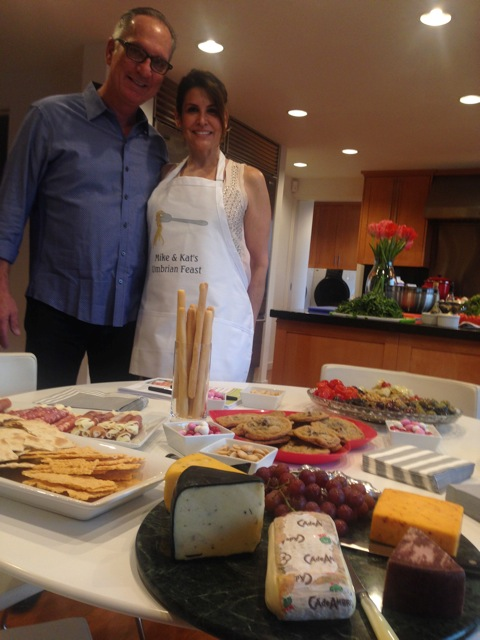 Kat and Mike with pre-cooking nibbles, ready for guests' arrivals