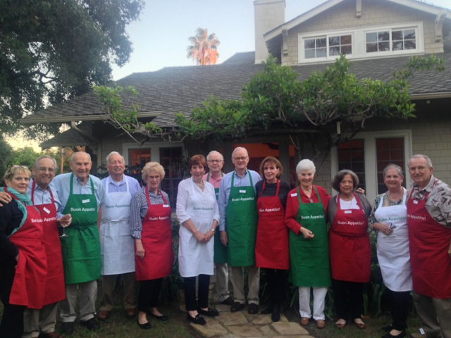 Mary and Ed and cooking class friends in new aprons