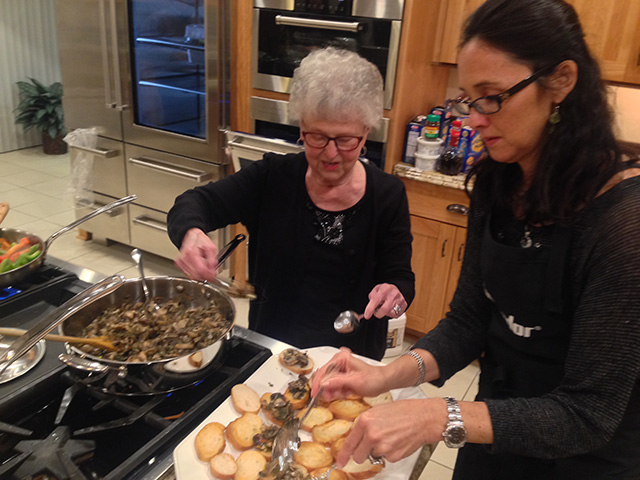 Stacy and Vivian handle the bruschetta con funghi trifolati