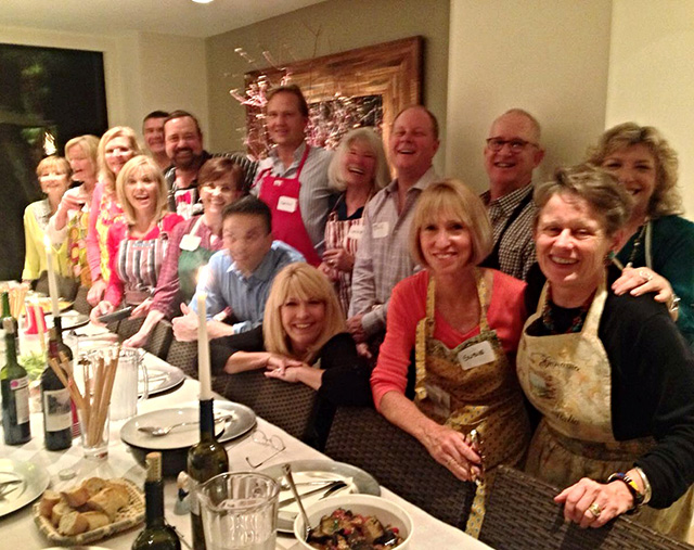 A united group gathers to enjoy the goodness cooked up