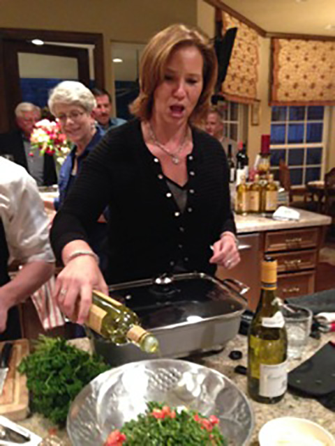 Angela adds more olive oil to our bruschetta