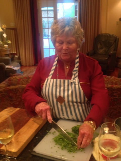 Cynthia on the arugula chopping