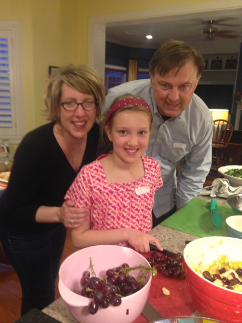 Emily on grapes with parents