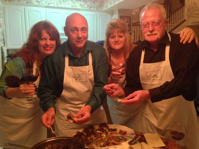 Mary Jo, Vic, Lora and Jim reliving their Italy experience in a Fresno kitchen