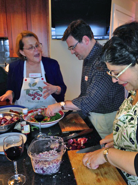 Laura and husband Michael chat with host Kathy as they cook