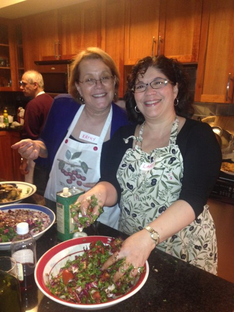 Laura mixing our salad -  with host Kathy