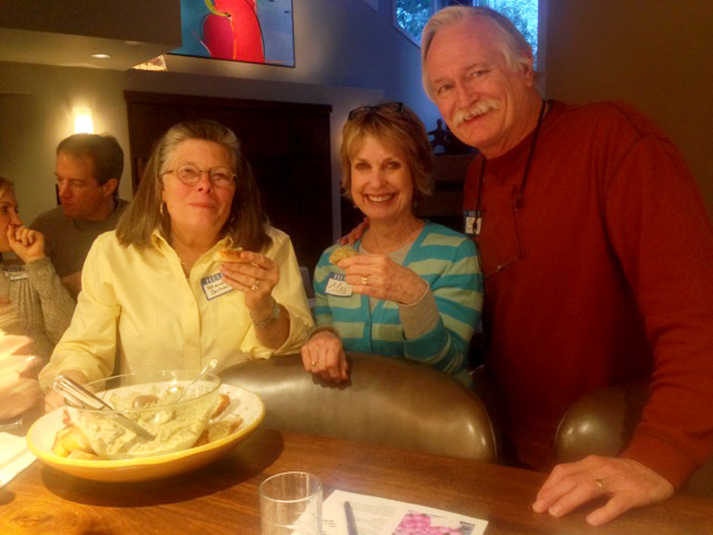 Maude enjoys the good flavors with fellow cooks, Meg and Chris