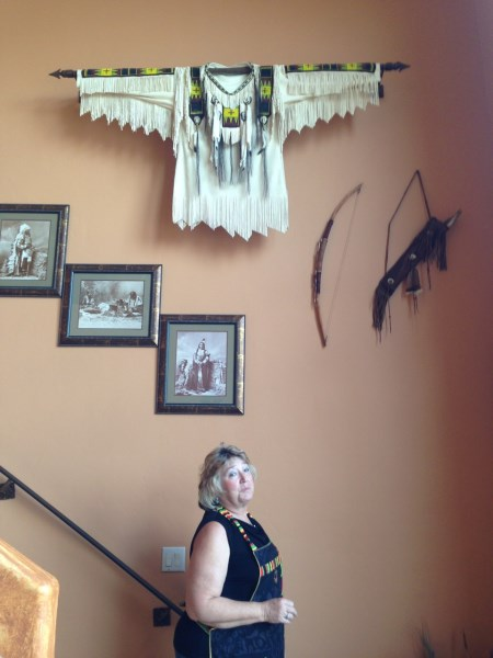 Suzi with Native American treasures on their walls