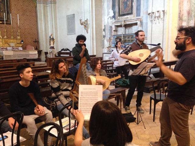 The choir of Sopra warms up in the San Vitale church