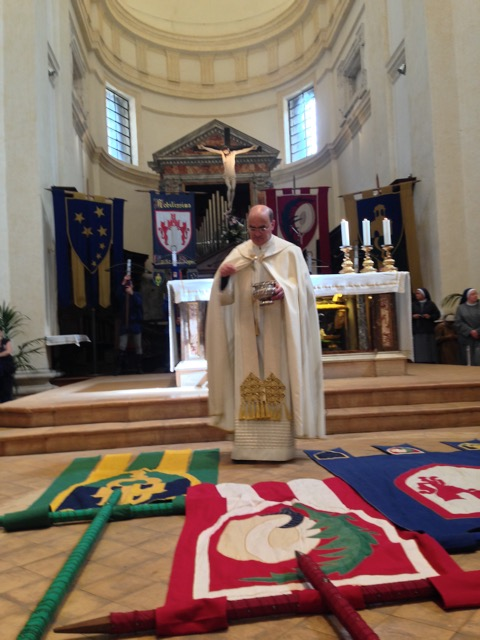 The priest blesses the three banners of Upper Assisi