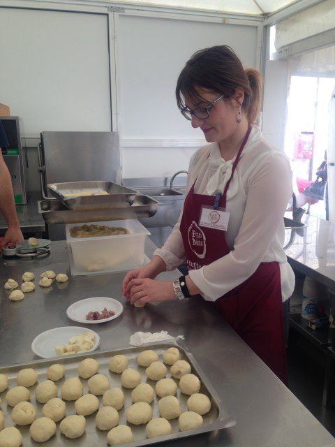 Samantha, Rosaria's assistant, works on the bomboloni