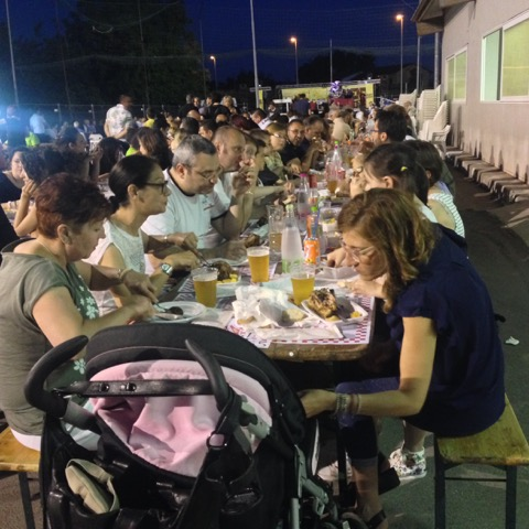 Families gather to share foods and conversation