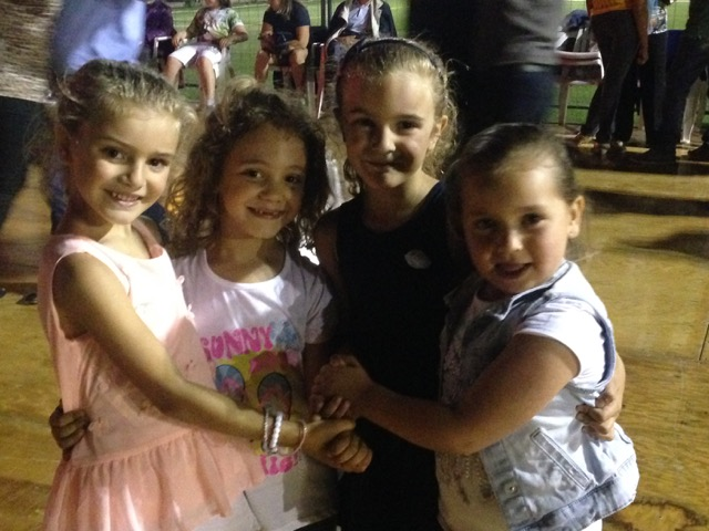 Four young dancing friends