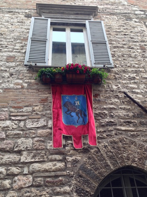 San Giorgio banner adorns a  window box