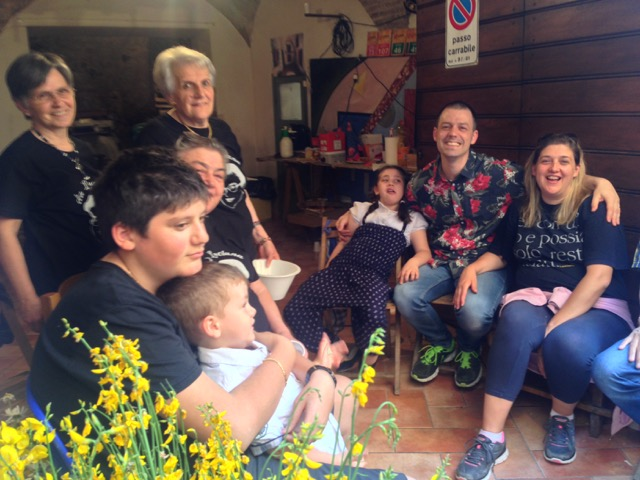 Giuseppe and Luciana's tired group sit and chat right alongside their floral masterpiece