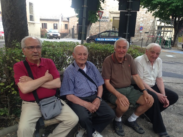 No wide-brimmed hat on Giuseppe (in brown shirt) this time…but a wide smile…