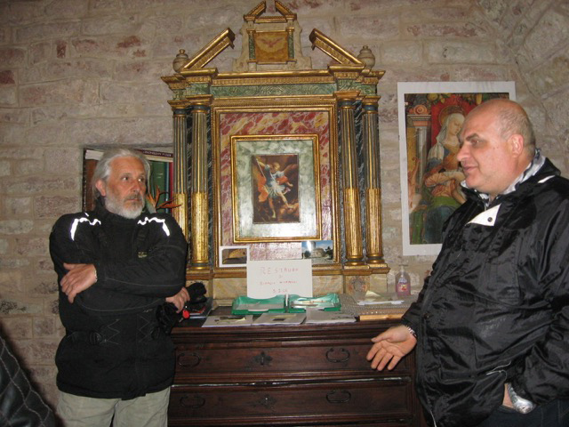 The custodian of the church recounts history to Pino