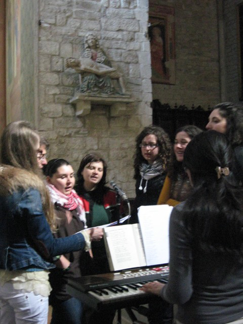 Young people singing their hearts out, the Pietà right behind them
